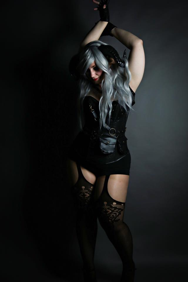 Goth Girl wearing Horns and Fishnet Stockings